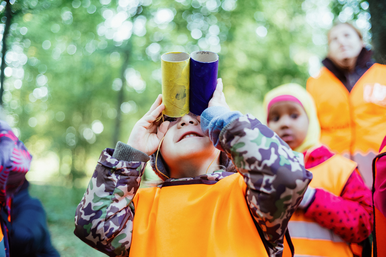 Kid looking thru binoculars